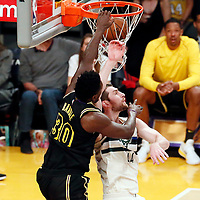 30 March 2018: Los Angeles Lakers forward Julius Randle (30) dunks the ball over Milwaukee Bucks center Tyler Zeller (44) during the Milwaukee Bucks 124-122 victory over the LA Lakers, at the Staples Center, Los Angeles, California, USA.