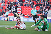 Doncaster Rovers defender Andrew Butler (6)  tackles Colchester United midfielder Sammie Szmodics (10)  during the EFL Sky Bet League 2 match between Doncaster Rovers and Colchester United at the Keepmoat Stadium, Doncaster, England on 15 October 2016. Photo by Simon Davies.