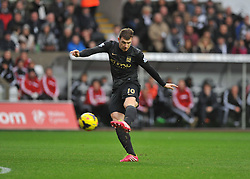 Manchester City's Edin Džeko shoots at goal. - Photo mandatory by-line: Alex James/JMP - Tel: Mobile: 07966 386802 01/01/2014 - SPORT - FOOTBALL - Liberty Stadium - Swansea - Swansea City v Manchester City - Barclays Premier League