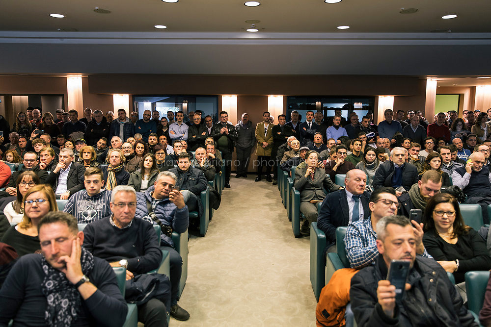 AVELLINO, ITALY - 11 FEBRUARY 2018: Supporters of the Five Stars Movement (M5S, Movimento 5 Stelle) listen to a speech by Luigi Di Maio (31), running for Prime Minister of Italy, during a rally in Avellino, Italy, on  February 11th 2018.<br /> <br /> The 2018 Italian general election is due to be held on 4 March 2018 after the Italian Parliament was dissolved by President Sergio Mattarella on 28 December 2017.<br /> Voters will elect the 630 members of the Chamber of Deputies and the 315 elective members of the Senate of the Republic for the 18th legislature of the Republic of Italy, since 1948.