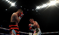 Josh Warrington (right) in action against Dennis Ceylan during their Featherweight bout at the First Direct Arena, Leeds.