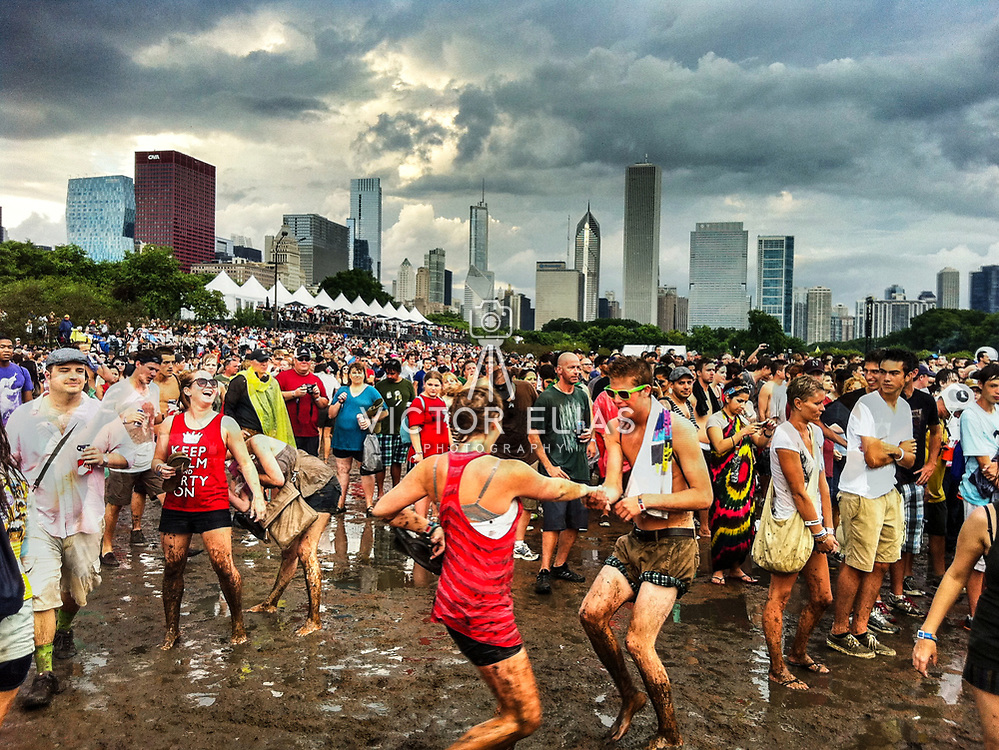 People dancing in the mud at Lollapaloosa Music Festival. Chicago, Illinois.