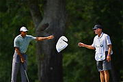 Sep 6, 2018; Newtown Square, PA, USA; Tiger Woods (left) and his caddie Joe LaCava (right) on the second hole green during the first round of the BMW Championship golf tournament at Aronimink Golf Course in Newtown Square, Pennsylvania on September 6, 2018.