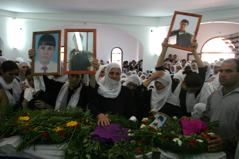 Sisters of A Druze Israeli soldier sergeant Tamer Amar holding his photos during a funeral in his home village Jolis in the north of Israel few kilometers from the border Lebanon tamer die during the Israeli operation in Lebanon. 2006- August13............