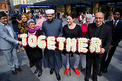 © Licensed to London News Pictures. 06/07/2015. London, UK. 7/7 survivor Gill Hicks (centre) walk with faith leaders: Rabbi Laura Janner-Klausner, Imam Qari Asim and Revd Bertrand Olivier from King's Cross station to Tavistock Square in a quiet moment of solidarity and reflection to commemorate the 10th anniversary of 7/7 bombings by remembering those who lost their lives, as well as offering a message of peace and unity between people of different faiths and backgrounds. Photo credit: Tolga Akmen/LNP
