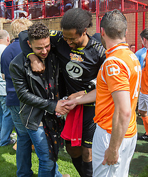 © Licensed to London News Pictures . 02/08/2015 . Droylsden Football Club , Manchester , UK . Actor ADAM THOMAS (l)shakes hands with DANNY MILLER (r) . Celebrity football match in aid of Once Upon a Smile and Debra , featuring teams of soap stars . Photo credit : Joel Goodman/LNP