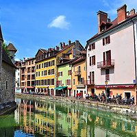 """Introduction to Annecy, France <br /> Annecy is a tourist town with about 50,000 residents in southeast France about 22 miles south of Geneva. It is nestled in a valley among four mountains at the northern end of Lac d'Annecy, a crystal clear lake stretching over ten square miles. Annecy's history can be traced back to 4th millennium B.C. and then the Romans in the 1st century B.C. Several of its current buildings, many of which line its canals, were built in the Middle Ages. It has been called the """"Venice of Savoie"""" and the """"Jewel of the French Alps."""" You can call it charming."""