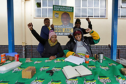 Wednesday 8th May 2019.<br /> JG Meiring High School, Goodwood Estate,<br /> Goodwood, Cape Town, <br /> Western Cape, <br /> South Africa.<br /> <br /> SOUTH AFRICAN GENERAL ELECTIONS 2019!<br /> <br /> SOUTH AFRICAN PROVINCIAL AND NATIONAL ELECTIONS 2019! <br /> <br /> An ANC political party member holds ups an ANC election poster with the face of South African President Cyril Ramaphosa on it as he and other representatives pose for a photo as they work on Election Day outside the voting station at JG Meiring High School, Goodwood Estate in Goodwood near Cape Town, Western Cape, South Africa.<br /> <br /> Registered South African Voters head to the various IEC (Independent Electoral Commission) Voting Stations where they are registered to vote as they cast their votes and take part in voting and other activities on Voting Day 8th May 2019 during the South African General Elections 2019. Voters from across the nation stood in queue's along with many others to vote in the Provincial and National Elections being held in South Africa on Wednesday 8th May 2019.   <br />  <br /> Copyright © Mark Wessels. All Rights Reserved. No Usage Without Permission.<br /> <br /> PICTURE: MARK WESSELS. 08/05/2019.<br /> +27 (0)61 547 2729.<br /> mark@sevenbang.com<br /> studioseven@mweb.co.za<br /> www.markwesselsphoto.com