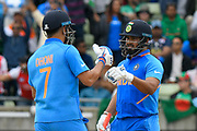 MS Dhoni of India and MS Dhoni of India touch gloves during the ICC Cricket World Cup 2019 match between Bangladesh and India at Edgbaston, Birmingham, United Kingdom on 2 July 2019.