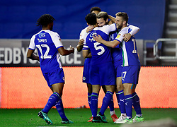 Wigan Athletic's Nick Powell (centre) celebrates scoring his side's first goal of the game with team mates during the Sky Bet Championship match at the DW Stadium, Wigan.