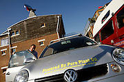 Bill Dunster, one of the architects behind the BedZED housing project is getting ready for work while driving a car powered by pure plant oil, in BedZED, on Thursday, Sep. 6, 2007. BedZED or the Beddington Zero Energy Development, is an environmentally-friendly housing development near Wallington, England in the London Borough of Sutton. It was designed by the architect Bill Dunster who was looking for a more sustainable way of building housing in urban areas in partnership between the BioRegional Development Group and the Peabody Trust. There are 82 houses, 17 apartments and 1,405 square meters of work space were built between 2000. The project was shortlisted for the Stirling Prize in 2003. The project is designed to use only energy from renewable source generated on site. In addition to 777 square meters of solar panels, tree waste is used for heating and electricity. The houses face south to take advantage of solar gain, are triple glazed and have high thermal insulation while most rain water is collected and reused. Appliances are chosen to be water efficient and use recycled water wherever possible. Low impact building materials were selected from renewable or recycled sources and were all originating within a 35 mile radius of the site to minimize the energy required for transportation. Also, refuse collection facilities are designed to support recycling and the site encourage eco-friendly transport: electric and LPG cars have priority over petrol/diesel cars, and electricity is provided by parking spaces appositely built for charging electric cars.