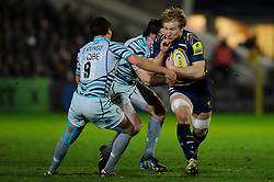 Worcester Flanker (#7) Matt Kvesic is tackled during the first half of the match - Photo mandatory by-line: Rogan Thomson/JMP - Tel: Mobile: 07966 386802 04/01/2012 - SPORT - RUGBY - Sixways - Worcester. Worcester Warriors v Leicester Tigers - Aviva Premiership.