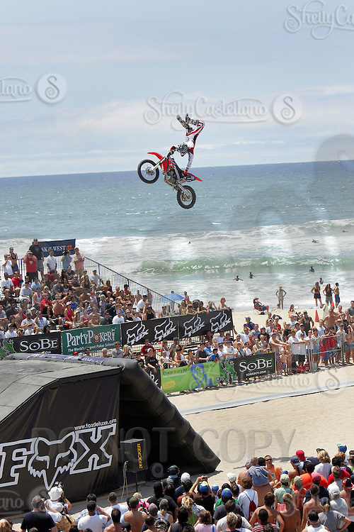 30 July 2006: FMX Freestyle Motocross Moto X rider Cam Sinclair in action doing tricks and catching big air on the 75' ramp on the final day of the 2006 Bank of the West Beach Games in Surf City Huntington Beach in Orange County Southern California, CA. Pacific Ocean serves as a backdrop behind the riders who perform for a few thousand fans on Sunday.