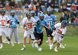 Virginia midfielder Peter Lamade (39) scoops up a loose ball from Johns Hopkins defenseman Matt Drenan (43).  The #2 ranked Virginia Cavaliers defeated the #6 ranked Johns Hopkins Blue Jays 13-12 in overtime at the University of Virginia's Klockner Stadium in Charlottesville, VA on March 22, 2008.  The loss, in front of a record UVA crowd of 7,500, was the third consecutive overtime defeat for Hopkins, the defending national champions.