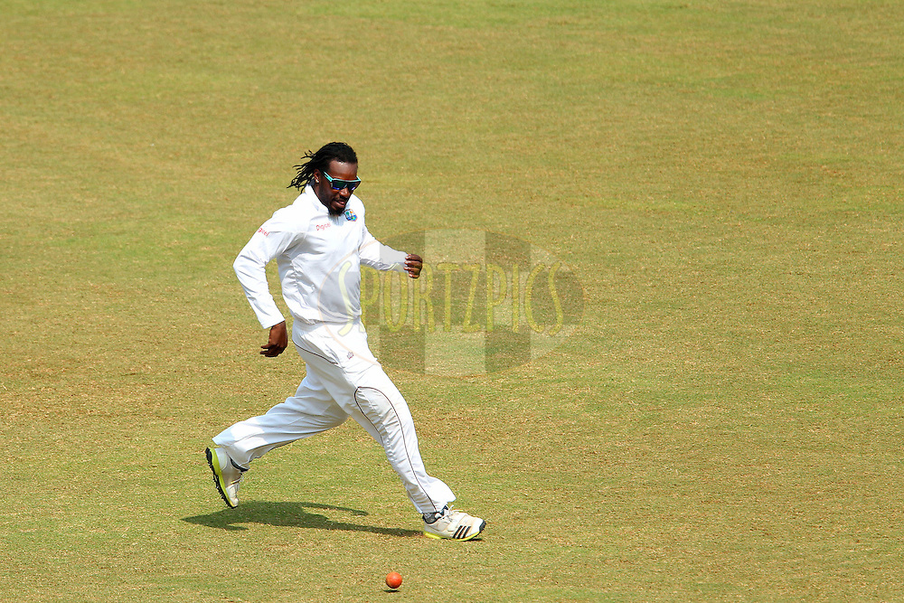 Chris Gayle of West Indies fields during day two of the second Star Sports test match between India and The West Indies held at The Wankhede Stadium in Mumbai, India on the 15th November 2013<br /> <br /> This test match is the 200th test match for Sachin Tendulkar and his last for India.  After a career spanning more than 24yrs Sachin is retiring from cricket and this test match is his last appearance on the field of play.<br /> <br /> <br /> Photo by: Ron Gaunt - BCCI - SPORTZPICS<br /> <br /> Use of this image is subject to the terms and conditions as outlined by the BCCI. These terms can be found by following this link:<br /> <br /> http://sportzpics.photoshelter.com/gallery/BCCI-Image-Terms/G0000ahUVIIEBQ84/C0000whs75.ajndY