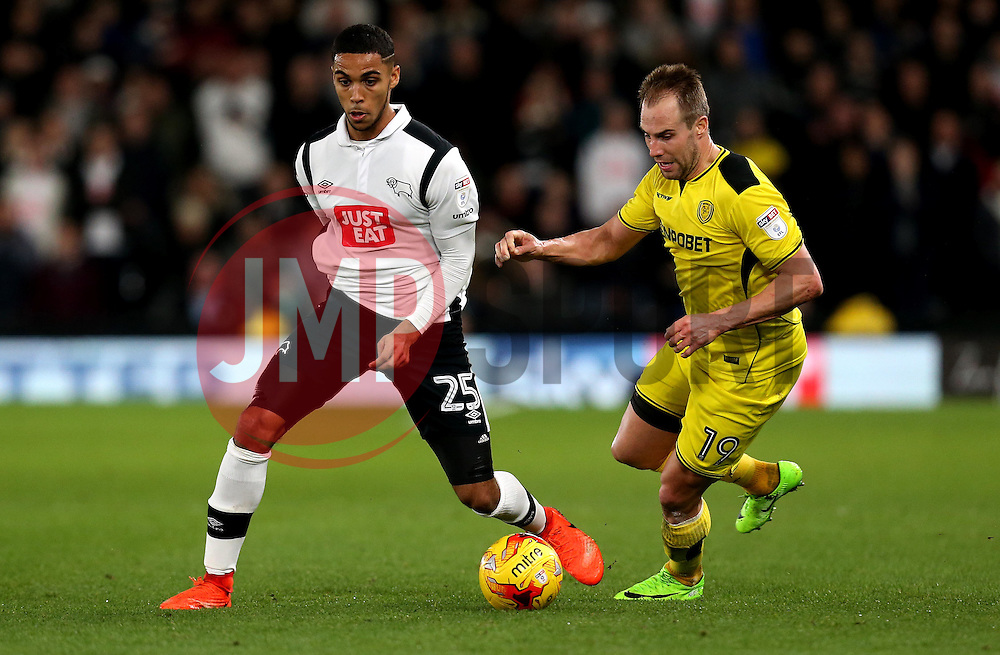 Max Lowe of Derby County goes past Luke Varney of Burton Albion - Mandatory by-line: Robbie Stephenson/JMP - 21/02/2017 - FOOTBALL - iPro Stadium - Derby, England - Derby County v Burton Albion - Sky Bet Championship