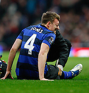 Picture by Andrew Tobin/Focus Images Ltd. 07710 761829. .21/01/12. Phil Jones (4) of Manchester United winces after hurting his leg and being carried off during the Barclays Premier League match between Arsenal and Manchester United at Emirates Stadium, London.