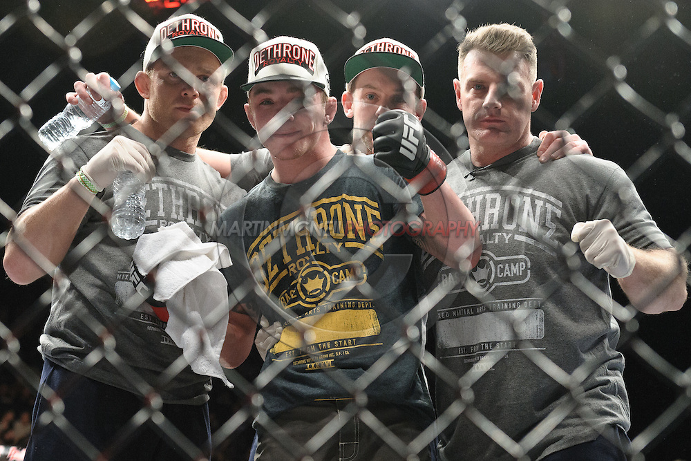 """LONDON, ENGLAND, FEBRUARY 16, 2013: Andy Ogle (center) poses with his team at """"UFC on Fuel TV 7: Barao vs. McDonald"""" inside Wembley Arena in Wembley, London on Saturday, February 16, 2013 (© Martin McNeil)"""