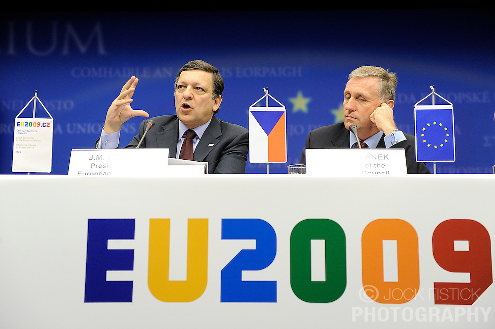 Jose Manuel, Barroso, president of the European Commission, left, speaks during a news conference, while Mirek Topolanek, prime minister of the Czech Republic, listens, following the European Union summit at EU headquarters in Brussels, Belgium, on Sunday, March. 1, 2009. .(Photo © Jock Fistick)