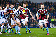 Burnley forward Sam Vokes (9) Burnley defender Michael Keane (5) and Burnley forward Ashley Barnes (10) all attack the corner during the Premier League match between West Bromwich Albion and Burnley at The Hawthorns, West Bromwich, England on 21 November 2016. Photo by Simon Davies.