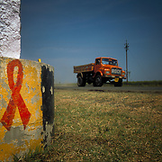 A warning sign for truck drivers against the dangers of HIV/AIDS is painted next to the road in Maharashtra, India