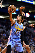 Jan 28, 2017; Phoenix, AZ, USA; Denver Nuggets guard Jamal Murray (27) drives the ball in front of Phoenix Suns center Tyson Chandler (4) in the first half of the NBA game at Talking Stick Resort Arena. Mandatory Credit: Jennifer Stewart-USA TODAY Sports
