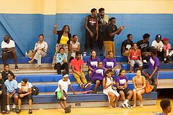 "The fans go wild.  Milton M. Newton Summer Classic featuring ""Nuff Respect"" (orange) versus  the ""Dream Chasers"".  Charlottel Amalie High School.  St. Thomas, USVI.  10 August 2016  © Aisha-Zakiya Boyd"