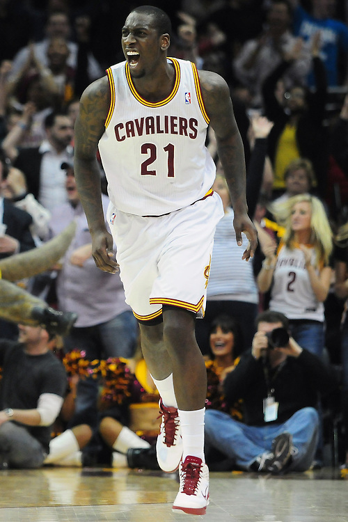 March 29, 2010; Cleveland, OH, USA; Cleveland Cavaliers power forward J.J. Hickson (21) celebrates after a dunk in the final minutes of the fourth quarter against the Miami Heat at Quicken Loans Arena. The Cavaliers beat the Heat 102-90. Mandatory Credit: Jason Miller-US PRESSWIRE