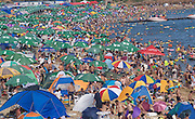 DALIAN, CHINA - AUGUST 18: (CHINA OUT) <br /> <br /> Heat Wave Hits China<br /> <br /> People enjoy themselves at a beach to beat the heat on August 18, 2013 in Dalian, Liaoning Province of China. <br /> ©exclusivepix