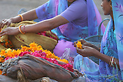 India, women preparing flowers for a funeral