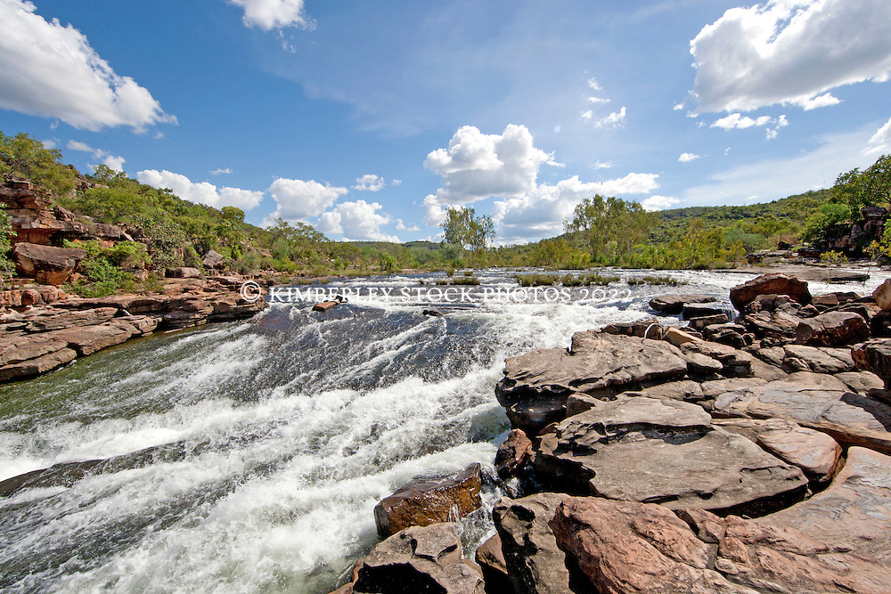 Water cascades down a small set of rapids on the Roe River in Western Australia's Kimberley.