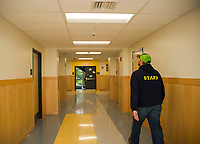 Facilities Director, Bill Caruso, walks through the hallway at Laconia Middle School showing the retrofit LED lighting that has been installed throughout the school.  (Karen Bobotas/for the Laconia Daily Sun)