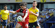 Luke Rooney shields the ball from Jake Wright during the Sky Bet League 2 match between Oxford United and Crawley Town at the Kassam Stadium, Oxford, England on 8 August 2015. Photo by Michael Hulf.