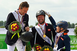Podium in the Freestyle Grade Ib Para Dressage 1. Lee Pearson and Zion, 2. Pepo Puch and Fine Feelins S, 3. Nicole den Dulk and Wallace - Alltech FEI World Equestrian Games™ 2014 - Normandy, France.<br /> © Hippo Foto Team - Leanjo de Koster<br /> 25/06/14