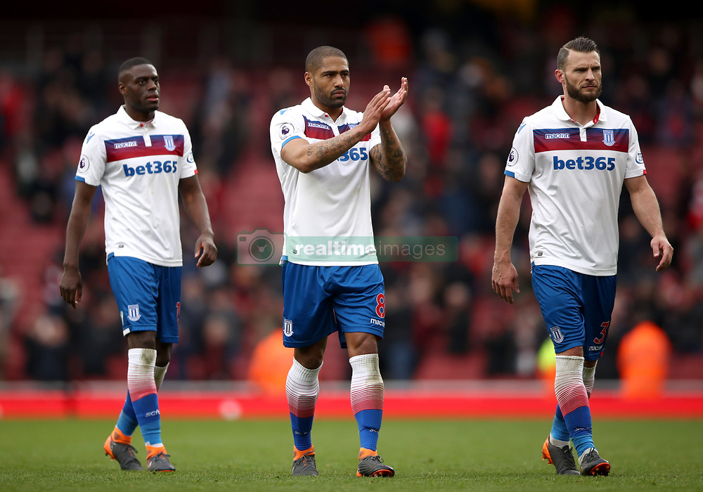 Stoke City's Bruno Martins Indi, Glen Johnson (centre) and Erik Pieters (right) gesture to the fans after the Premier League match at The Emirates Stadium, London.