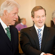 February 9, 2012 - New York, NY :  Former U.S. President Bill Clinton, left,.Taoiseach (Irish Prime Minister) Enda Kenny, center, and Tanaiste (deputy Irish Prime Minister) Eamon Gilmore shake hands with American and Irish-American business leaders at the start of a roundtable at New York University on Thursday morning, Feb. 9, 2012..CREDIT: Karsten Moran for The Irish Independent