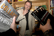 Author Christopher Hitchens chugs on a smoke during a book signing in Chicago, Illinois.