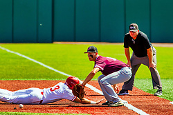20 May 2019:  Tim Catton watches as John Rave dives back safely to first past the tab by J.T. Weber. Missouri Valley Conference Baseball Tournament - Southern Illinois Salukis v Illinois State Redbirds at Duffy Bass Field in Normal IL<br /> <br /> #MVCSPORTS