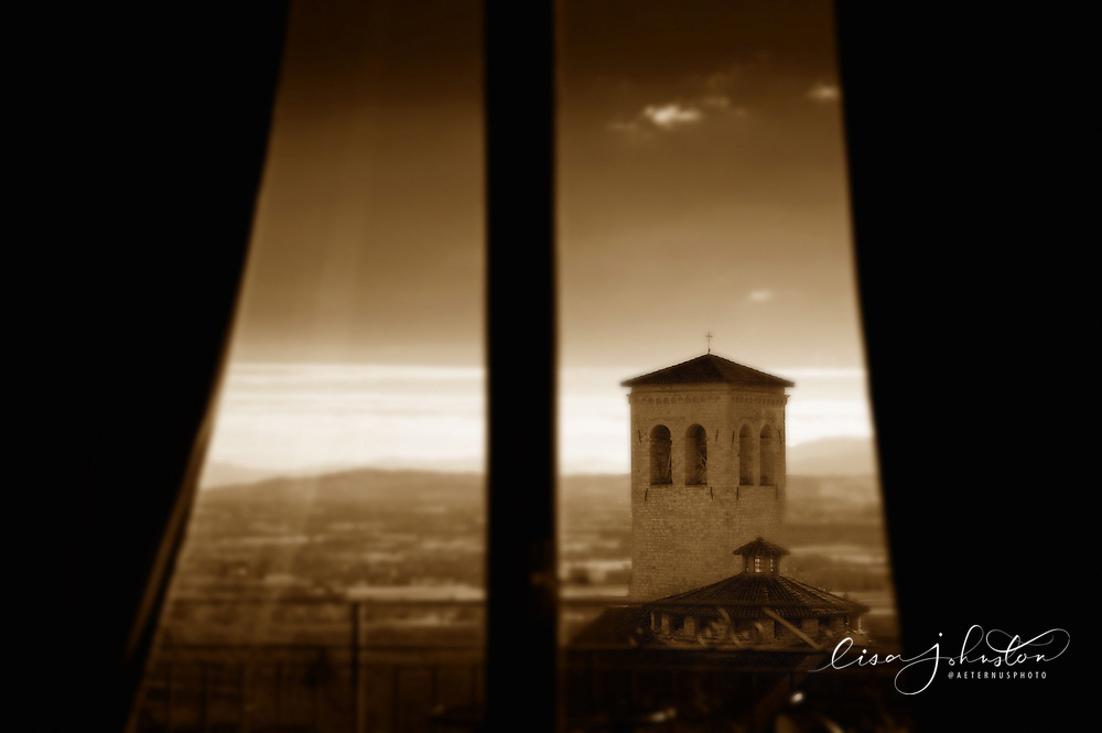 Church of St. Peter | Chiesa di San Pietro through a window in Assisi, Italy.