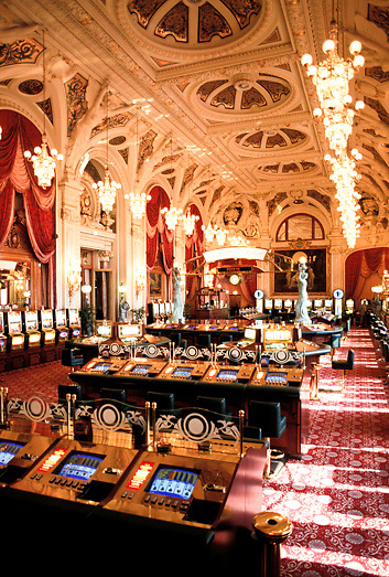 Slot machines and gaming tables inside the casino of Monte Carlo in Monaco on the French Riviera