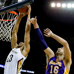Nov 8, 2013; New Orleans, LA, USA;  New Orleans Pelicans power forward Anthony Davis (23) dunks over Los Angeles Lakers center Pau Gasol (16) during the first quarter of a game at New Orleans Arena. Mandatory Credit: Derick E. Hingle-USA TODAY Sports