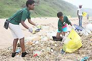 Nsindiso Sibiya (l) and Senamile Magwanza participate in the beach clean up organized  by Southern Durban Community Environmental Alliance (SCDEA)/KZN, 1 December 2011