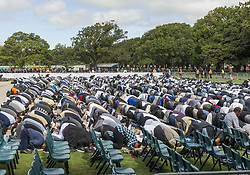 March 22, 2019 - Christchurch, Canterbury, New Zealand - An estimated 5,000 Muslims and 15,000 other community members attend a Call to Prayer service in Hagley Park, across the street from the Al Noor mosque. In addition to prayers and a brief talk from the imam of Al Noor, two minutes of silence were observed nationwide in memory of those killed in the terrorist attack at the Al Noor and Linwood mosques. Later in the day, 26 of the victims were scheduled to be buried at Memorial Park Cemetery. Later in the day, 26 of the victims were scheduled to be buried at Memorial Park Cemetery. (Credit Image: © PJ Heller/ZUMA Wire)