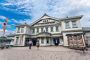 Photo shows the exterior of the Korakukan theater, Japan's oldest extant wooden playhouse in Kosaka, Akita Prefecture Japan on 11 Aug. 2015. Made entirely from wood, the theater was opened in 1910 and was registered as an Important Cultural Property in 2007. Photographer: Rob Gilhooly