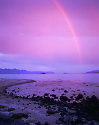 6103-1007LVT ~ Copyright: George H. H. Huey ~ Rainbow at dawn from the north end of Isla San Francisco, looking toward Isla Coyote and Baja's Sierra de la Giganta. Sea of Cortez, Mexico.