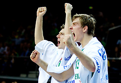 Goran Dragic of Slovenia and his broher Zoran Dragic of Slovenia react during basketball game between National basketball teams of Slovenia and Lithuania at of FIBA Europe Eurobasket Lithuania 2011, on September 15, 2011, in Arena Zalgirio, Kaunas, Lithuania. Lithuania defeated Slovenia 80-77.  (Photo by Vid Ponikvar / Sportida)