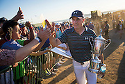 Jordan Spieth celebrates with fans after winning the 115th U.S. Open Championship at Chambers Bay in University Place, Washington.