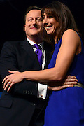 © Licensed to London News Pictures. 10/10/2012. Birmingham, UK Prime Minister David Cameron hugs his wife Samantha after he delivers his keynote speech at The Conservative Party Conference at the ICC today 10th October 2012. Photo credit : Stephen Simpson/LNP