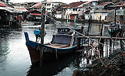 Boats moored in Sangai Melaka river running through the historical city of Melaka, Malaysia