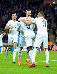 Danny Welbeck of England (Arsenal) celebrates  scoring  his first goal of the game with Wayne Rooney of England (Manchester United) and Kieran Gibbs (Arsenal)   - Photo mandatory by-line: Joe Meredith/JMP - Mobile: 07966 386802 - 15/11/2014 - SPORT - Football - London - Wembley - England v Slovenia - EURO 2016 Qualifier